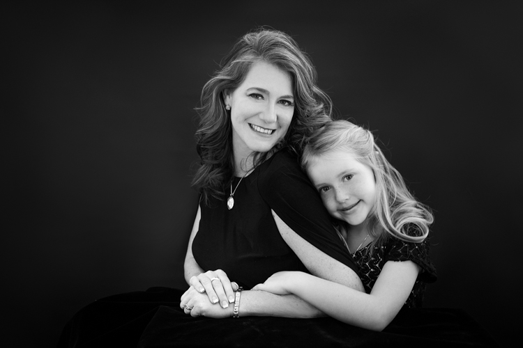 Black and white portrait of a mother and daughter
