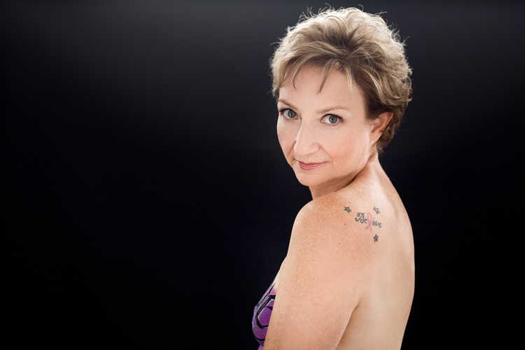 Portrait of a breast cancer survivor with a tattoo on her shoulder