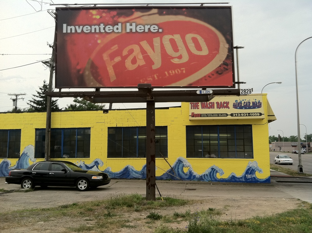 <strong>Black Sedan under under Faygo billboard</strong>
