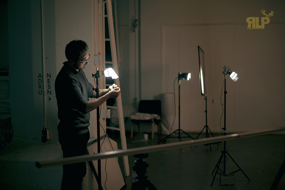 Key Grip, René Arseneau, adding diffusion on Goal Zero's Light-A-Life to add fill lights for the talent.