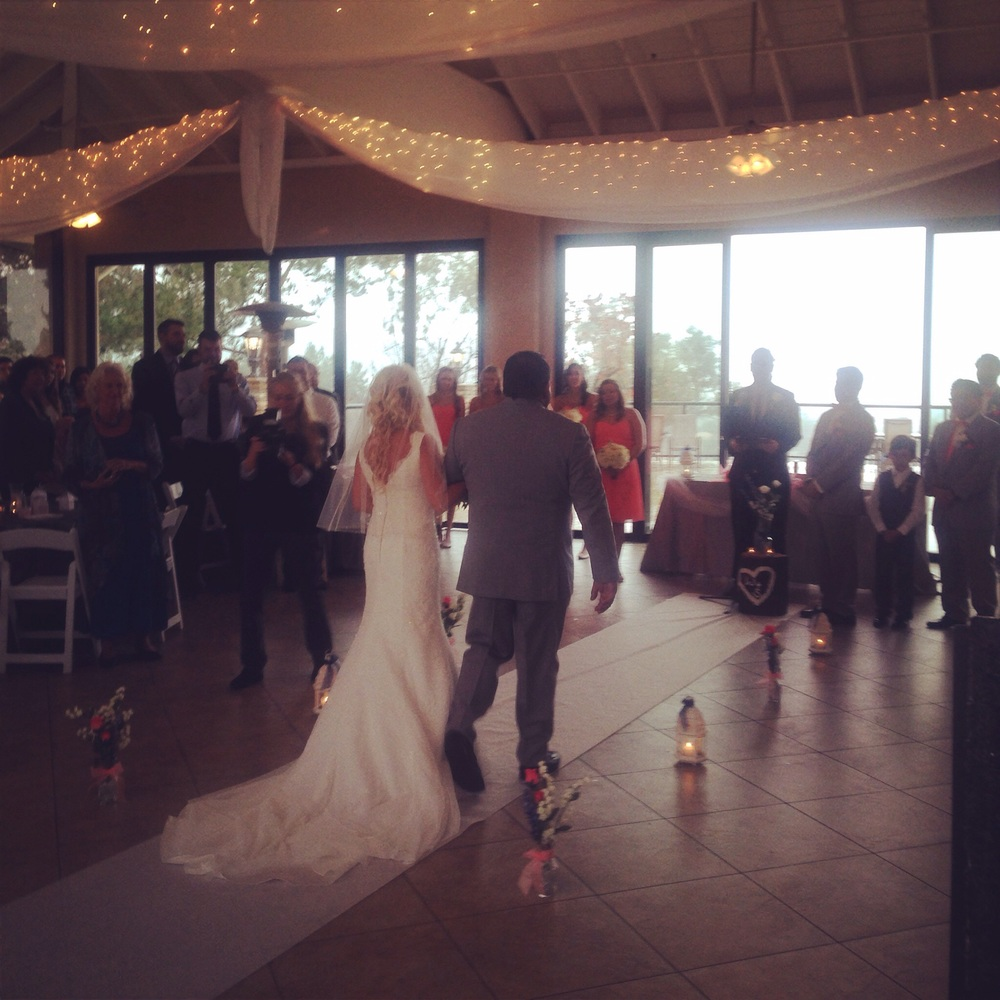 Samantha makes her way down the aisle toward a waiting William at Steele Canyon Golf Course.