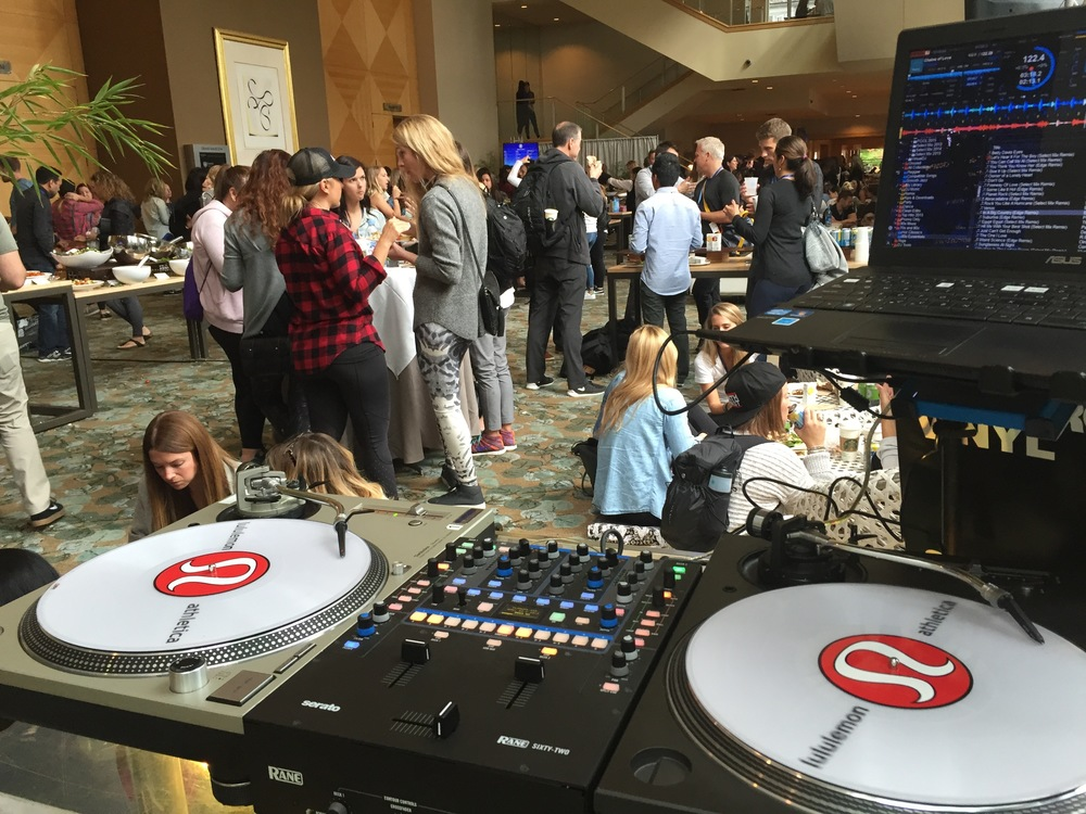 My view from the DJ booth while conference attendees converse over breakfast.