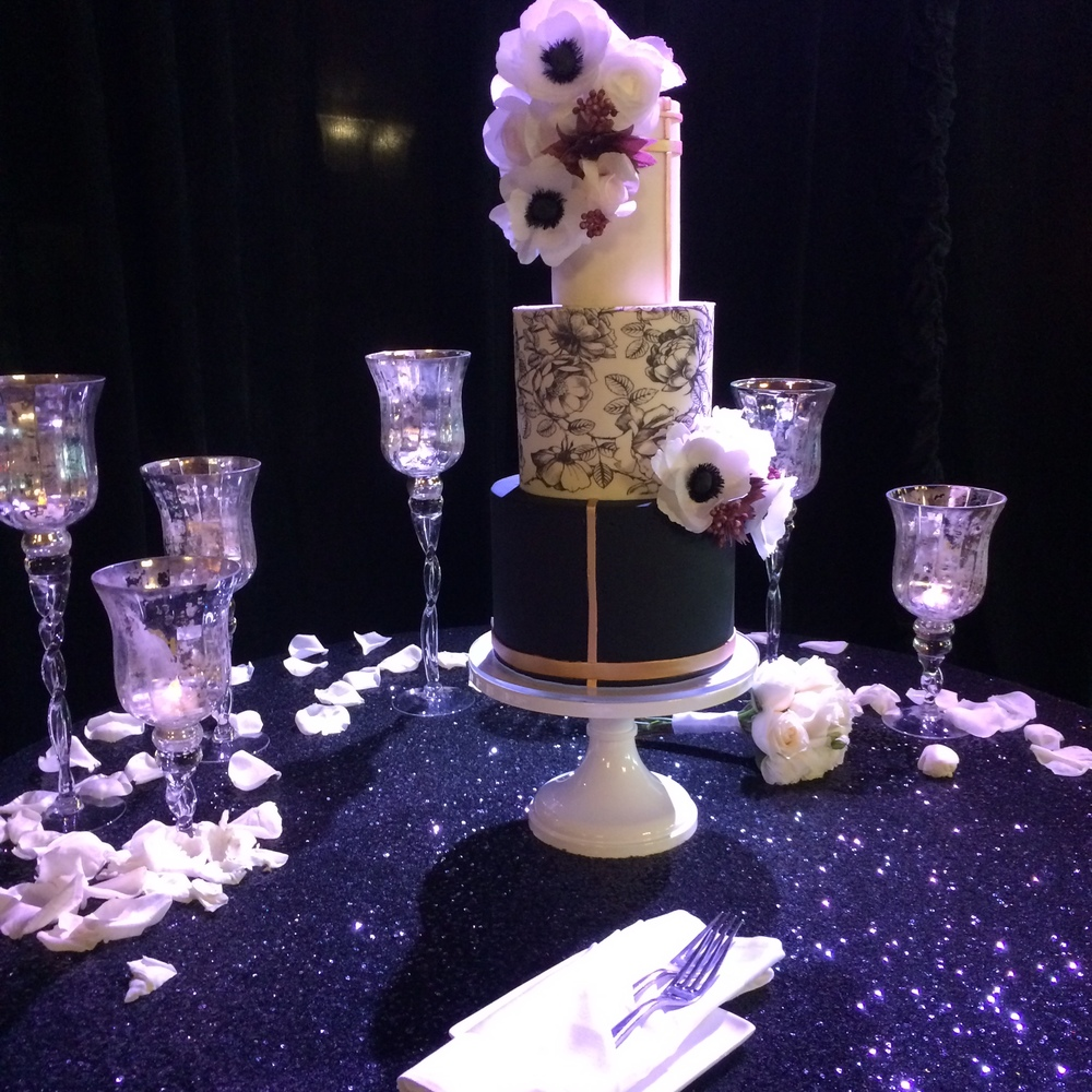 A wedding cake with a spotlight nicely illuminates this focal point of every wedding reception.