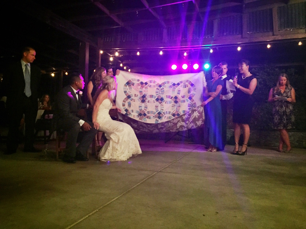 Friends and family presented Jonathan and Elizabeth with a handmade quilt as a wedding gift.