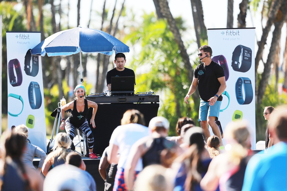 DJ Justin Kanoya on stage with Sheri Matthews and Mike Sherbakov as they kick off the Fitbit Local program in San Diego.