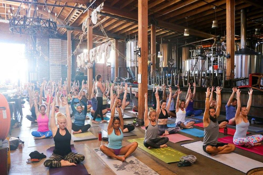 This isn't your typical yoga space. Mission Brewery in downtown San Diego was the venue for a Movember Foundation fundraiser featuring a yoga flow led by Lauren Padula, with live music spun by DJ Justin Kanoya.