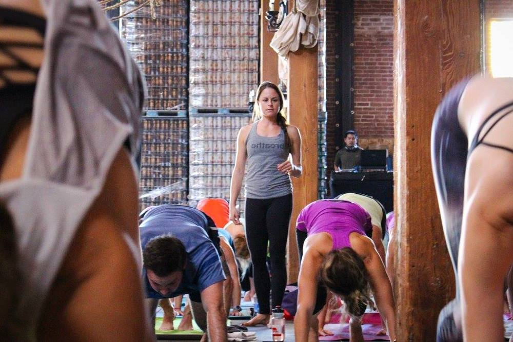 Lauren Padula leads a yoga session to benefit the Movember Foundation.