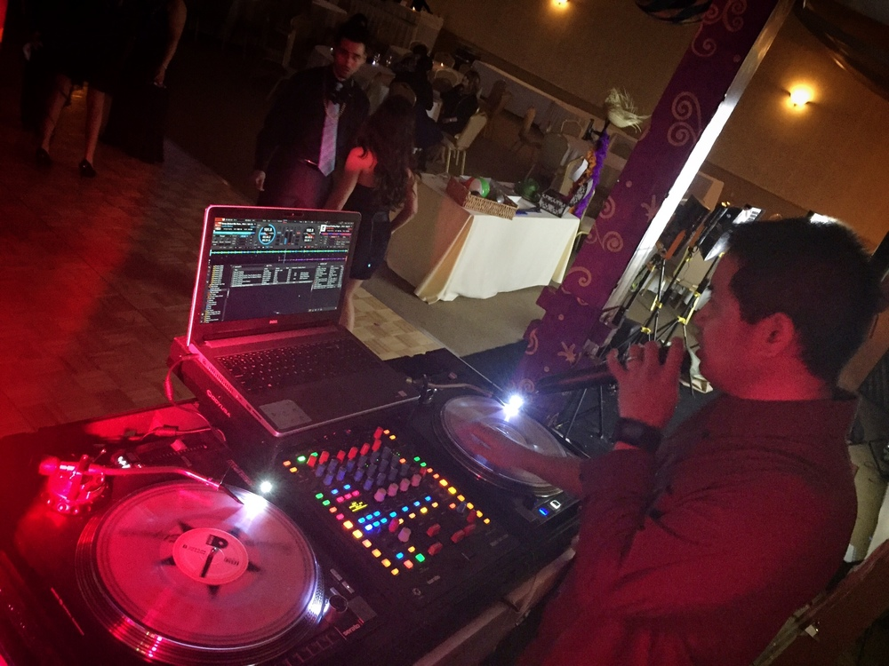 DJ Justin Kanoya MC's the Pacific Marine Credit Union Holiday Party at South Coast Winery.