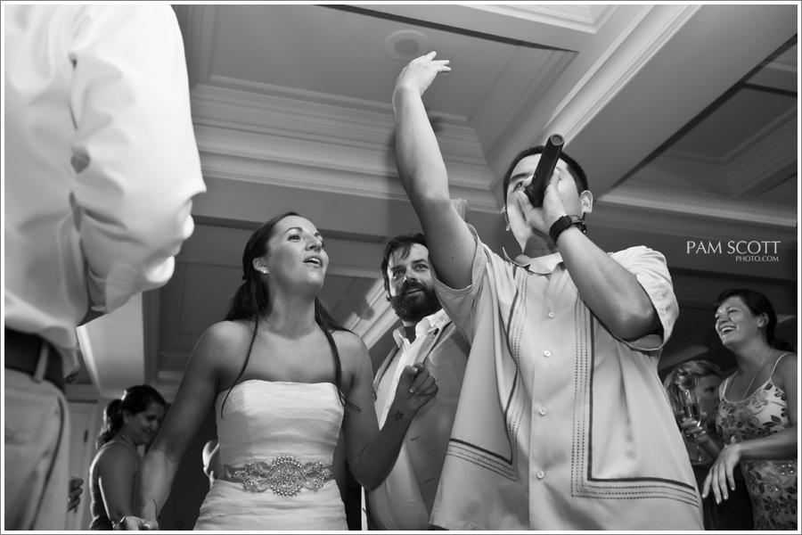 San Diego DJ, Justin Kanoya, gets onto the floor and hypes the crowd up alongside the bride and groom. PHOTO: Pam Scott Photography