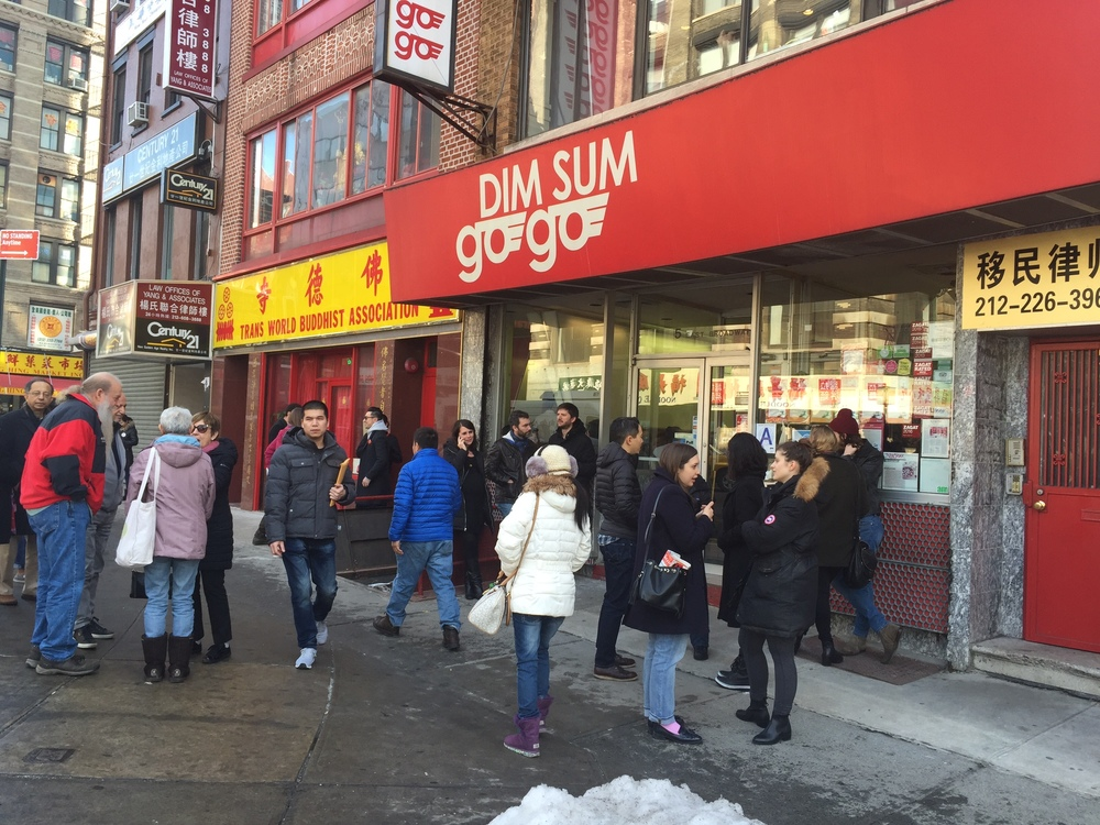 A line of patrons waits to be seated at Dim Sum Go Go in New York's Chinatown.
