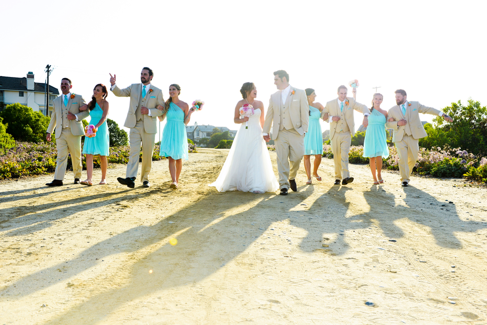 Allison and Blake's vibrant wedding party walk up to Levyland Estates in Carlsbad, California.