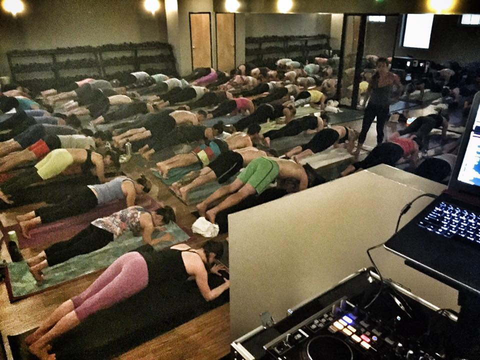 Students flow to music of DJ Justin Kanoya and the teaching of Katie Burke at CorePower Yoga.