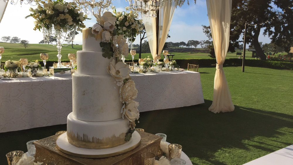 An elegant wedding cake awaits the traditional cake cutting at this wedding celebration at the Lodge at Torrey Pines.