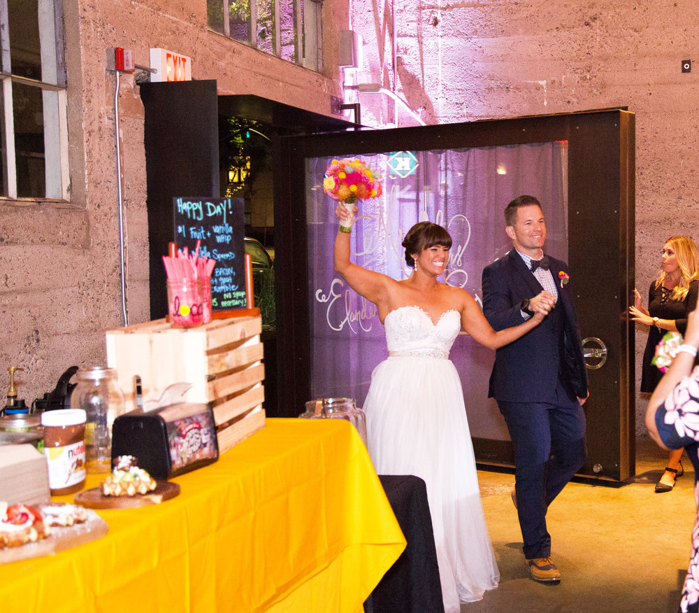 Erik and Melanie enter their wedding at Luce Loft in downtown San Diego.