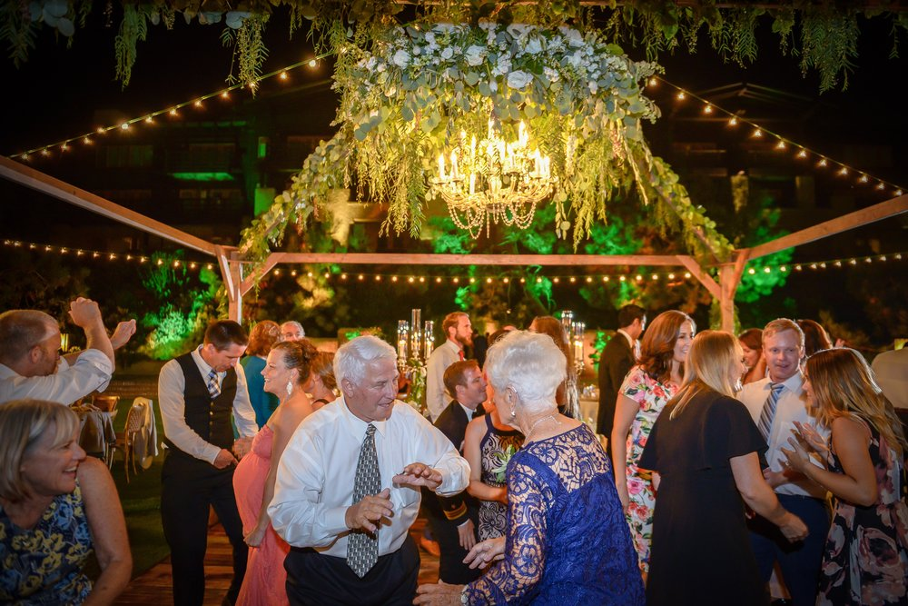 Guests at Sheri and Jason's Lodge at Torrey Pines wedding take a dance break from their dinner.