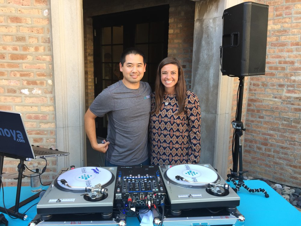 DJ Justin Kanoya, with   Fitbit Health Solutions Senior Event Marketing Manager, Andrea Conti.