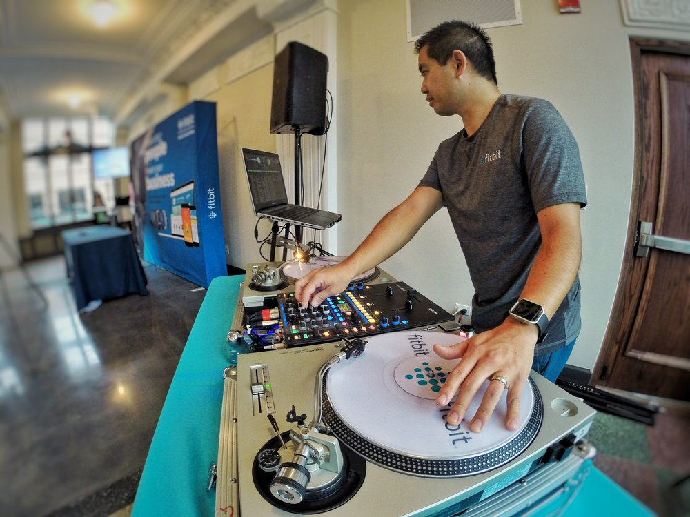 DJ Justin Kanoya, spins music at the Fitbit Captivate conference in Chicago.