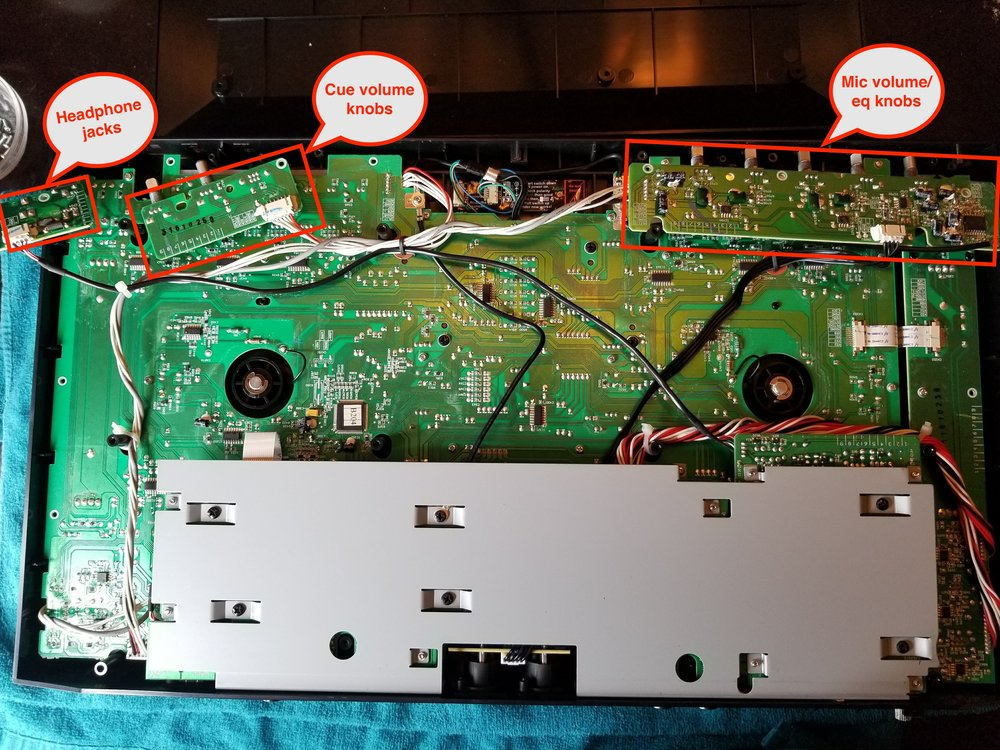 Removing these three circuit boards, held in place by small screws, is necessary to lift off the MC4000s faceplate and gain access to the crossfader.