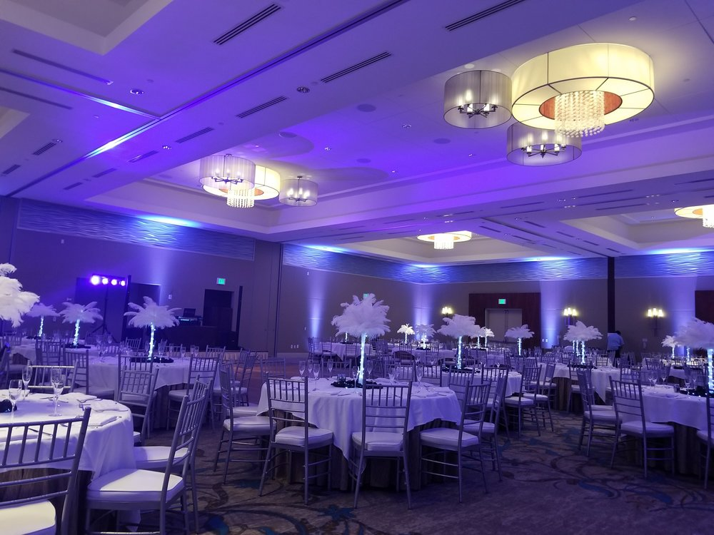 Pacific Marine Credit Union celebrated at the Cape Rey resort in Carlsbad. Uplighting in the room added to the design of the Mardis Gras theme.