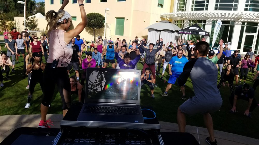 Sheri Matthews Kimmel and Mike Sherbakov lead a Fitbit Local San Diego workout at the Bay Club.