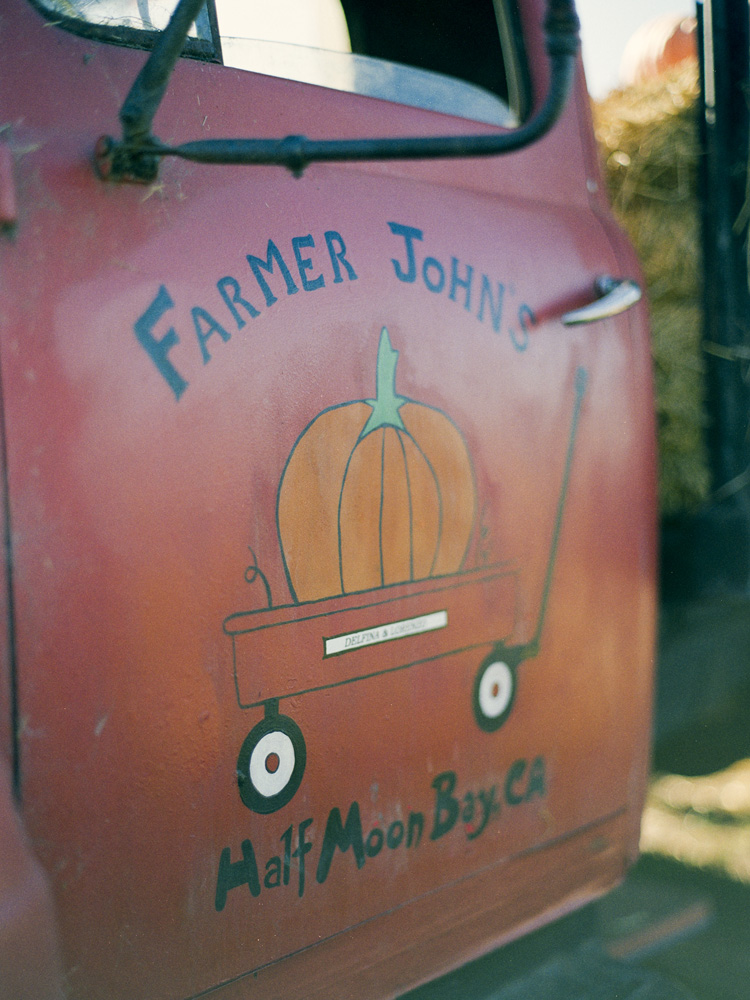 Farmer John's Pumpkin Patch Sign in Half Moon Bay