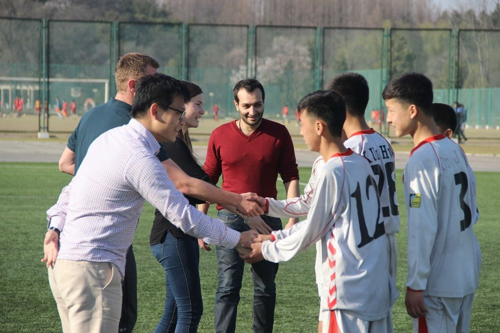 Student delegates introduces themselves to the DPRK (U-16)Football team.  Pyongyang,April 2016