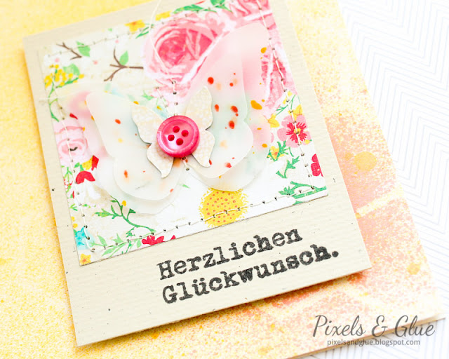 detail of handmade birthday card with vellum butterfly and misted background