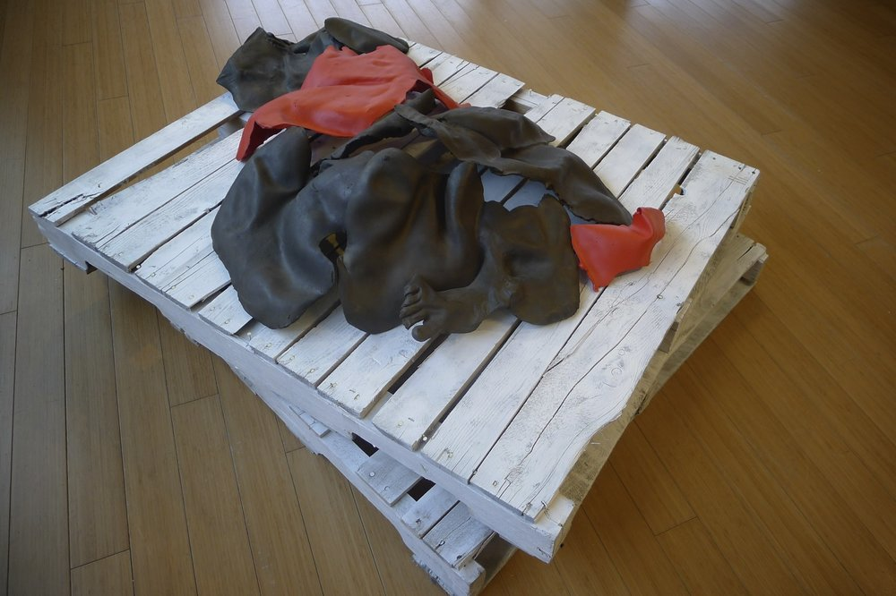 "Compression, Fragment // Cast iron, plaster, steel, paint, pallets // 50"" x 48"" x 14"""