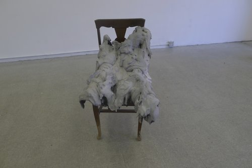 "Slumpbody // Plaster, burlap, charcoal, chair // 21"" x 28"" x 40"""