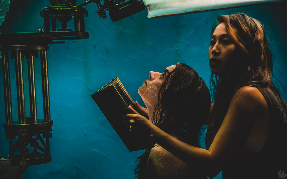 Maureen Renee Hughes, left, and director Joy Song frame up an overhead shot on the set of QUIETUS. (Oleg Bolotov/Auspicious Phoenix Productions)