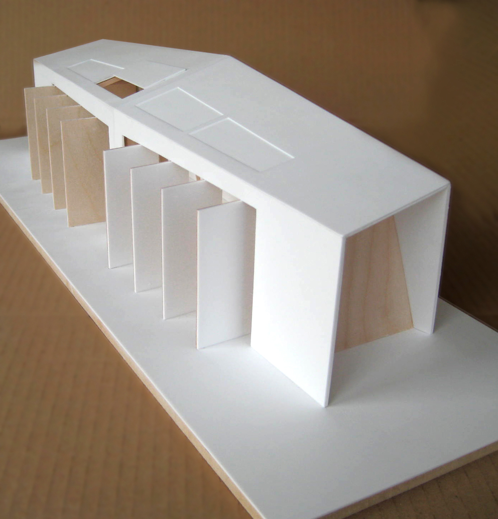 White and timber model of beach house design