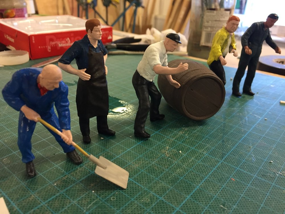 The amended model figures, perhaps having a dance off??