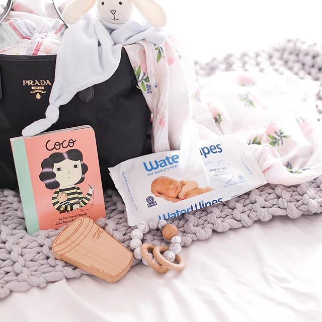"My nappy bag essentials : Baby Emm's favourite Coco Chanel book, her teethers and my ABSOLUTE must, my trusty Water Wipes. @waterwipesaustralasia . —— My little family has been using Water Wipes since day dot so I'm really excited to be collaborating with them to share with you how truly awesome of a baby product they are. They're safe for your little ones to use on hands, face and bumbum ! We've used it for so long that every time I bring it out Emm says ""Hi baby!"" 😂 —— #sp #waterwipesarepure"