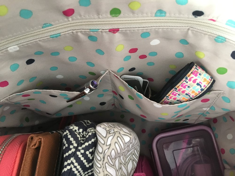 Zipper pocket and interior pouches for essentials