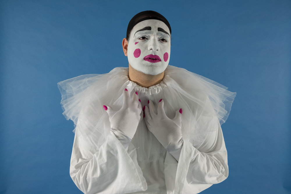 Queerrot's Profile - Queerrot (they/them) is a queer mime who is perpetually in search of company. The inspiration behind them comes from commedia dell'arte, a genre of semi-improvised street theatre originating from 16th century Italy and in particular the character Pierrot: an innocent white-face clown who faces rejection and bullying from the rest of the troupe.Queerrot marries my passion for queer theory and culture with the lineage of Pierrot and clowning, and their adventures explicate how queer individuals who look different are marginalised from society and their own communities.