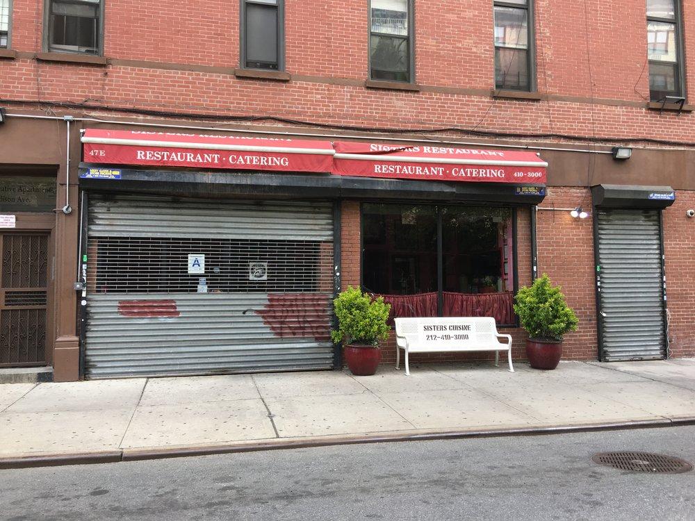 sisters cuisine -- will be replacing gate soon.JPG