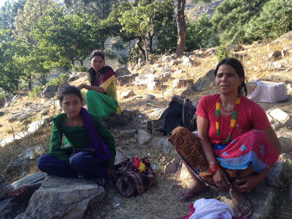 Woman and Girls resting on the walk to Oda with necessary household supplies.