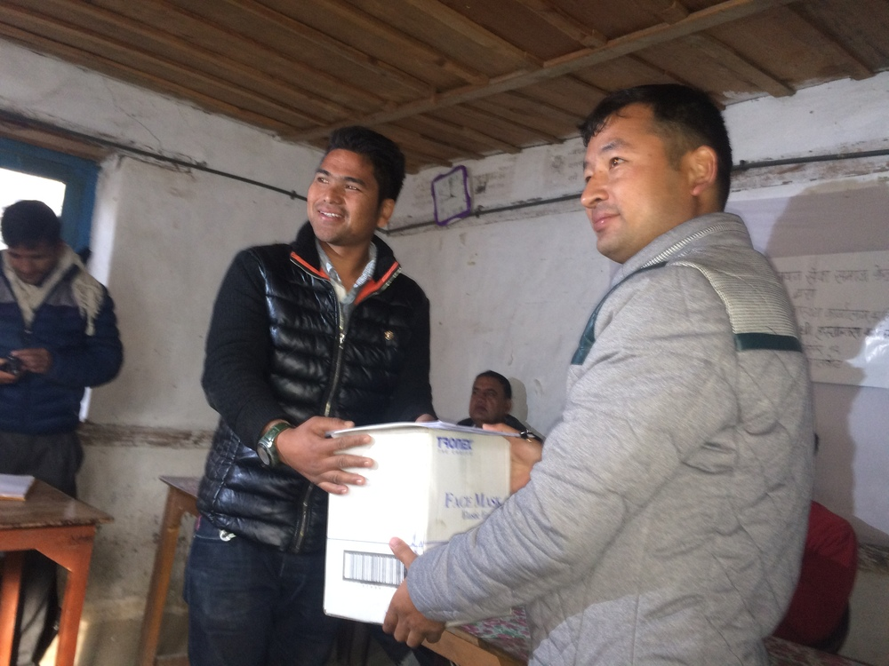 Karan Singh providing the ceremonial first box of supplies to District Health Officer and Friend Dr. Shankar Lohala.