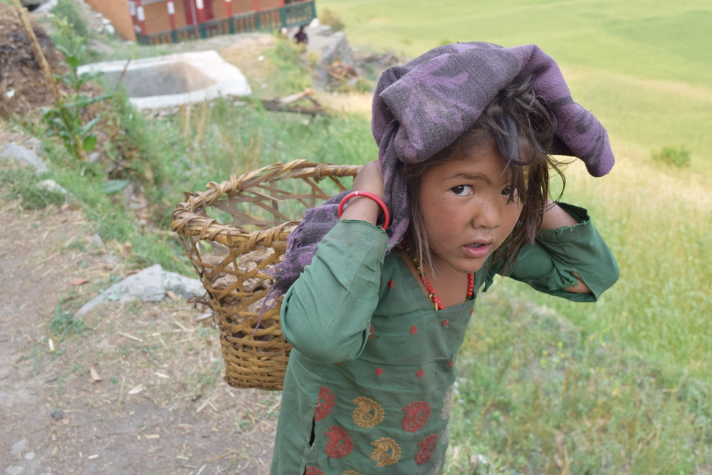 Even the youngest kids must work to support their families - carrying supplies over 16 hours.