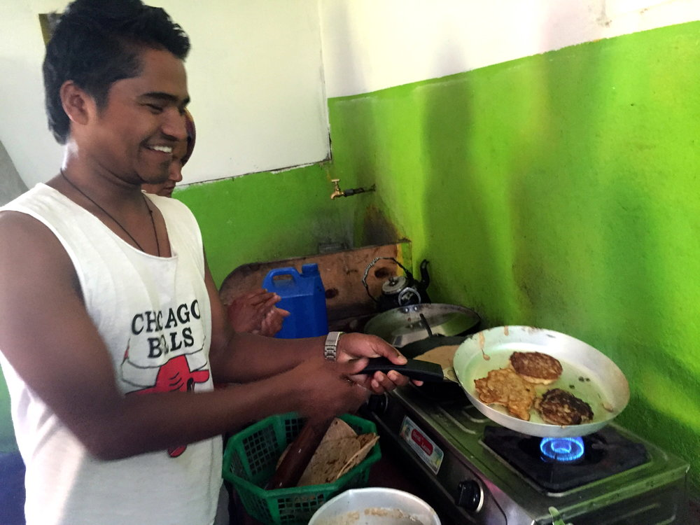 Medical staff member, Narendra, cooking up banana pancakes in our kitchen