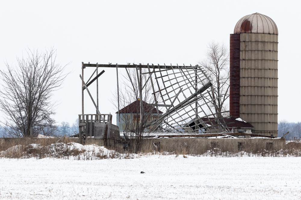 Silo with Damaged Buildings