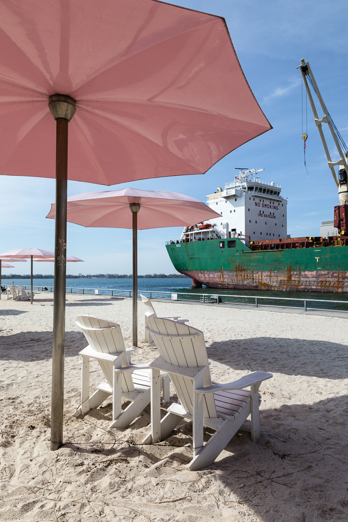 Sugar Beach with a Freighter in Dock with a Load of Raw Sugar