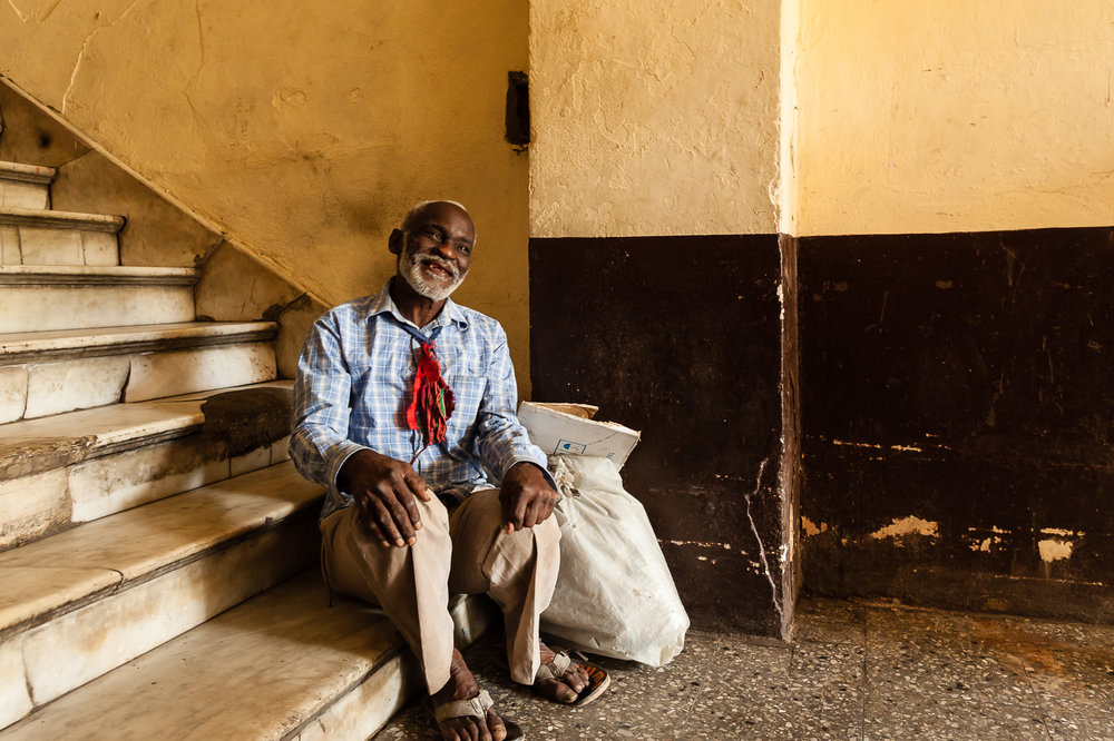 Cuban Man Resting on the Steps