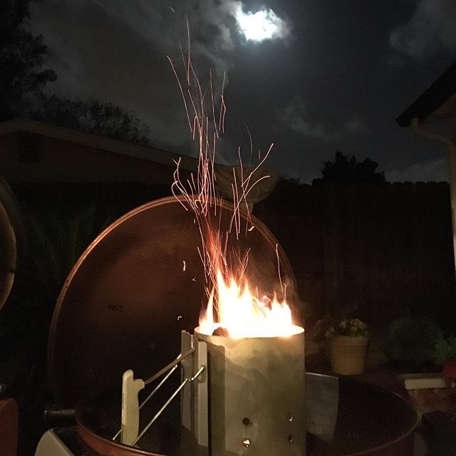 Getting the chimney started by moonlight. #championshipsunday #brisket.