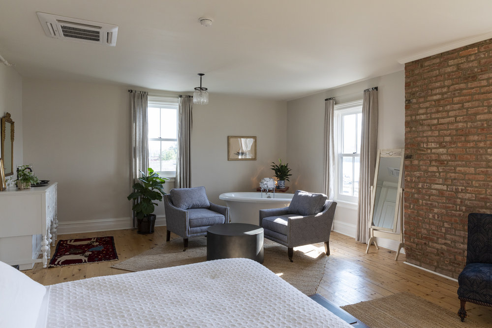 This luxurious third floor suite offers a large living area with soaking tub and antique wet bar, king sized bed and spectacular view of the Hudson River. - 500 sq ft$349.00 per night for up to 2 people