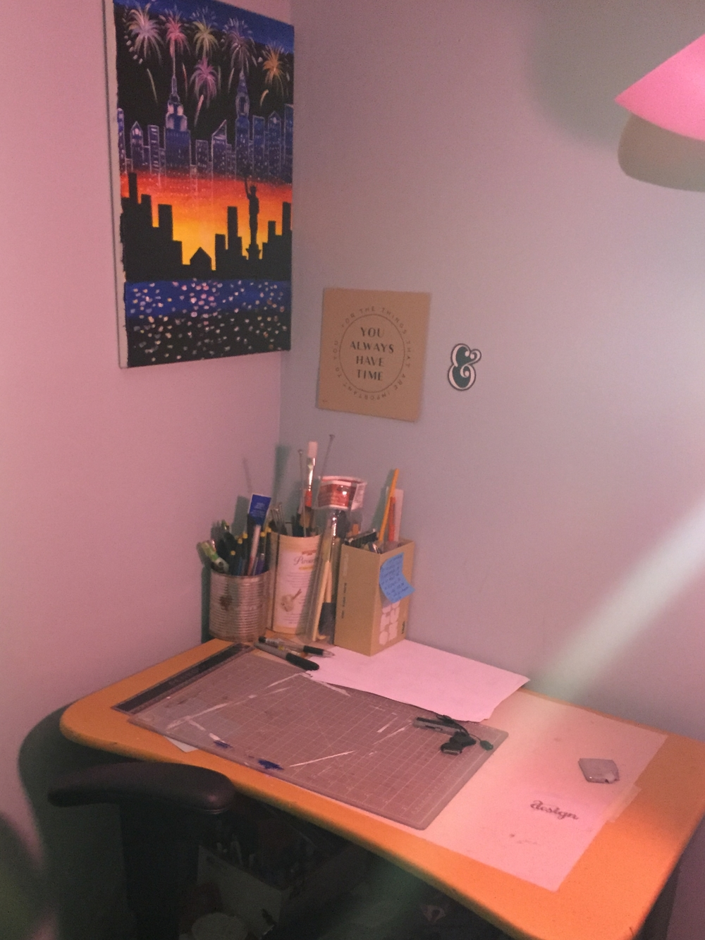 A close up of where I go to practice. Do you notice a theme?   On the desk I have a cutting mat and my paint Brushes.   I need to add more wall art!