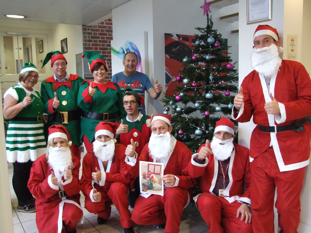 Back Row (Elves) – Jacqui Brown, Jim Smith, Christine Byford, Rick Forsyth, Sean Hopkins Front Row (Santas) – Julie Christie, Dawn Blackburn, Andy Reed, Mike Fielding, James Farthing