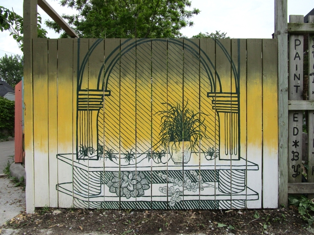 Purify Your Air mural  on fence around community garden on Milky Way ave, Toronto  2015