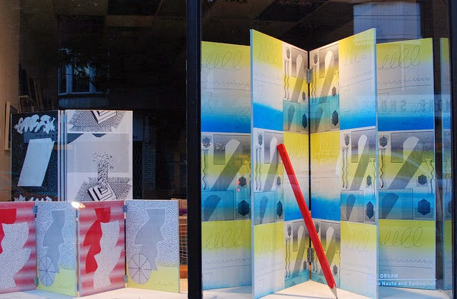 Zine Dream window  Three screenprinted wooden book sculptures and giant wood pencil  Eunice Luk and Alicia Nauta  Art Metropole  August 2014