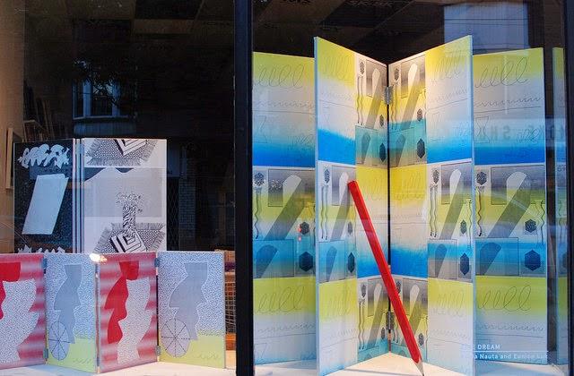 Zine Dream window  Three screenprinted wooden book sculptures and giant wood pencil  Eunice Luk and Alicia Nauta  Art Metropole  August 2014